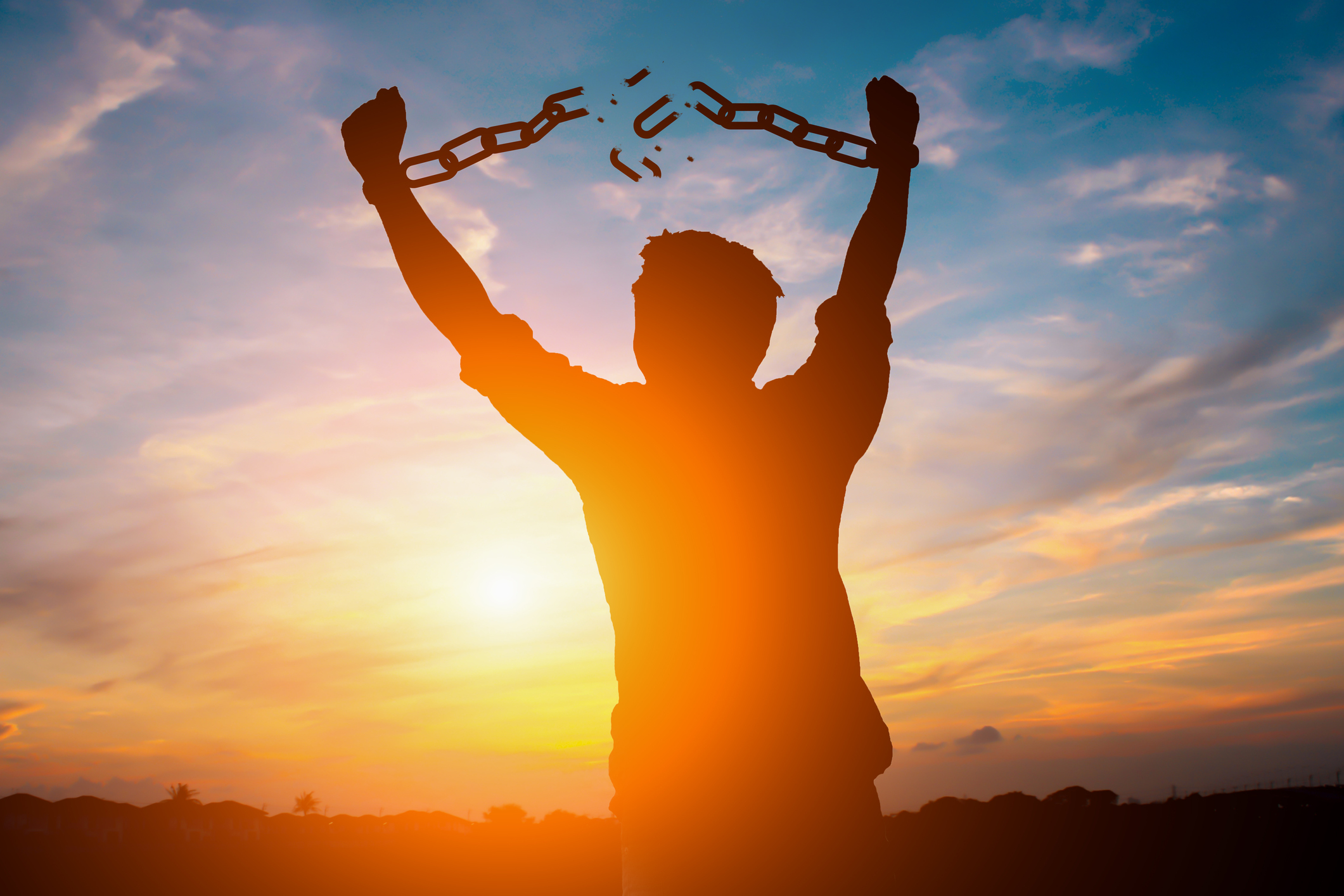 Image of Person Breaking Chains